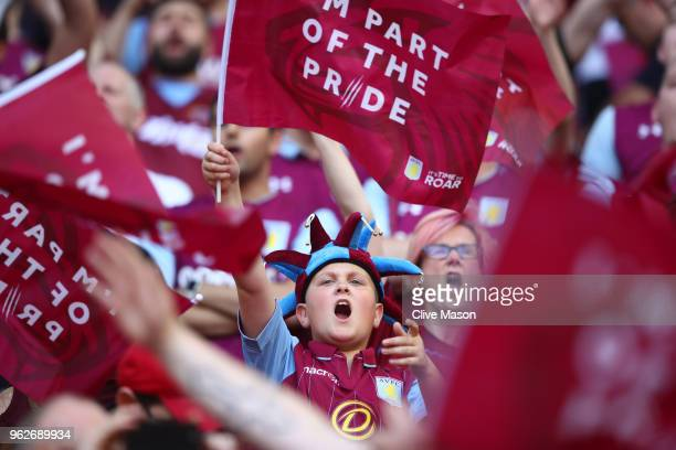 Aston Villa fan cheers on her team prior to the Sky Bet Championship Play Off Final between Aston Villa and Fulham at Wembley Stadium on May 26 2018...