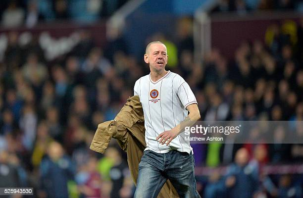 Aston Villa fan invades the pitch to taunt the West Bromwich Albion Fans