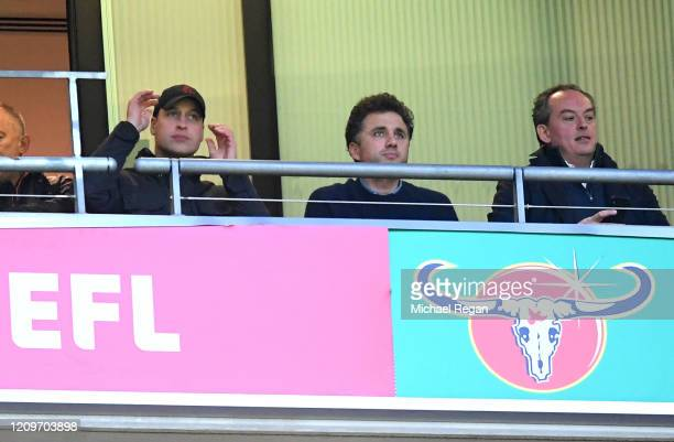 Aston Villa fan Prince William Duke of Cambridge watches with Thomas van Straubenzee on from the stands during the Carabao Cup Final between Aston...