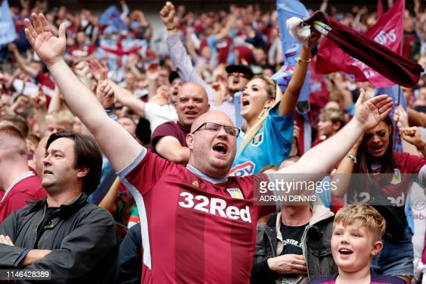 Aston Villa fans celebrate after scoring during the English Championship playoff final football match between Aston Villa and Derby County at Wembley...