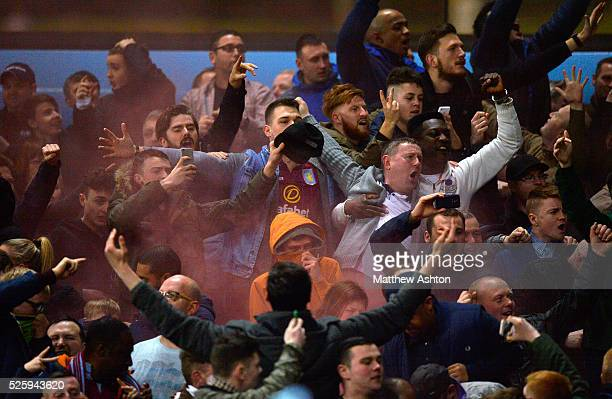 Aston Villa fans celebrate after they go ahead after a Fabian Delph of Aston Villa goal to make it 10 by letting off smoke flares