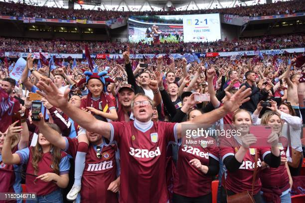 Aston Villa fans celebrate promotion to the Premier League after the Sky Bet Championship Playoff Final match between Aston Villa and Derby County at...