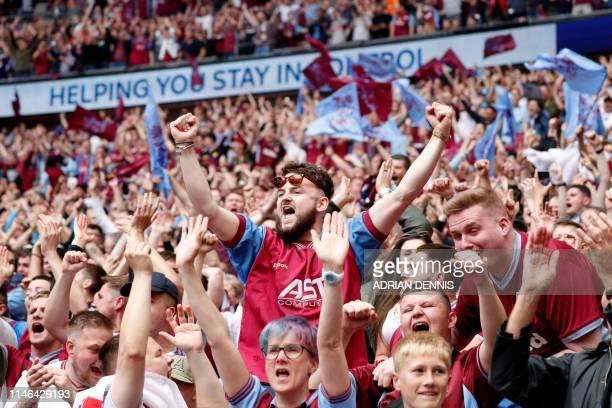 Aston Villa fans celebrate their first goal during the English Championship playoff final football match between Aston Villa and Derby County at...