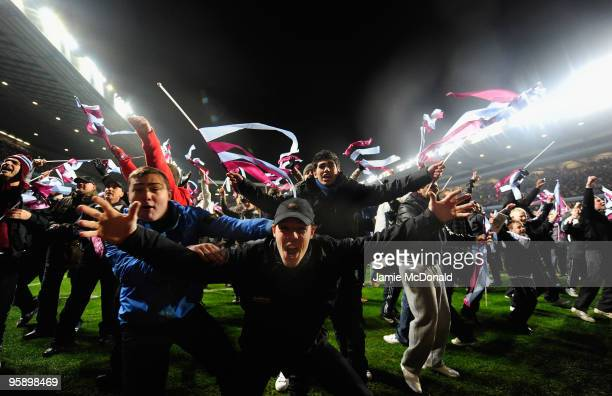Aston Villa fans celebrate victory during the Carling Cup SemiFinal second leg match between Aston Villa and Blackburn Rovers at Villa Park on...
