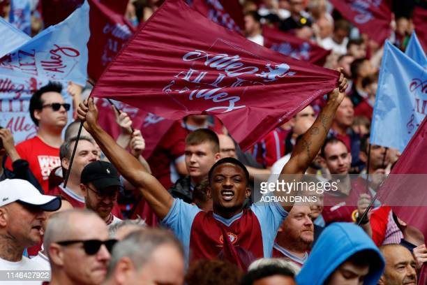Aston Villa fans cheer their team during the English Championship playoff final football match between Aston Villa and Derby County at Wembley...