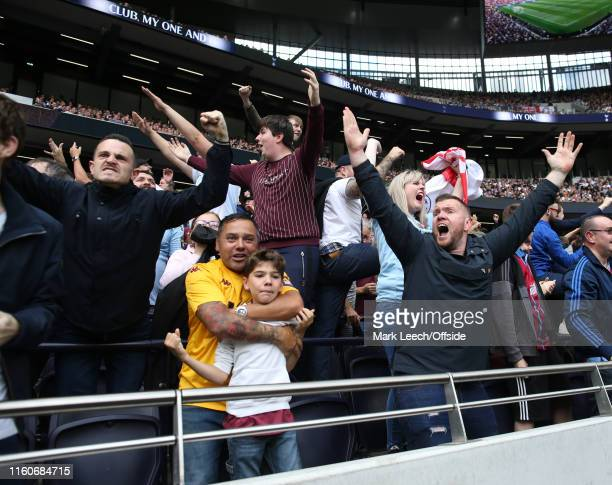 Aston Villa fans get excited and celebrate their early goal during the Premier League match between Tottenham Hotspur and Aston Villa at Tottenham...