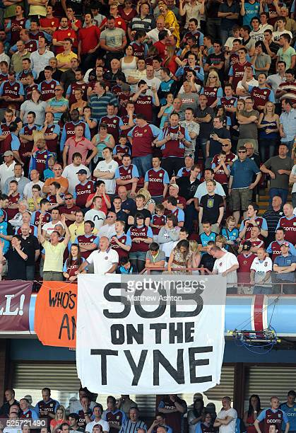 Aston Villa fans hold up a banner reading Sob on the Tyne as Newcastle United are relegated