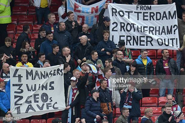Aston Villa fans hold up banners referencing their 1982 European Cup victory in Rotterdam and their possible relegation to the Championship where...
