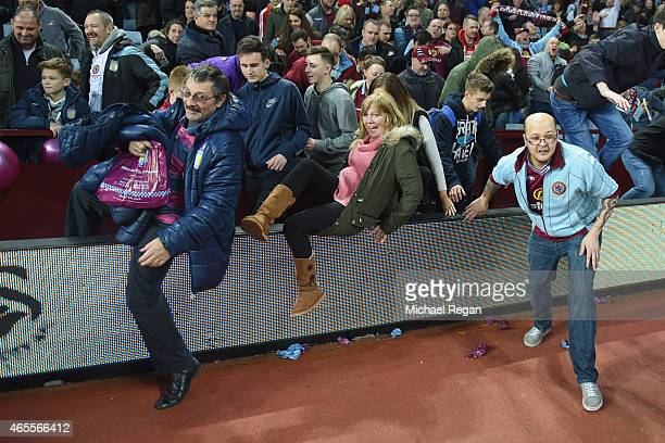 Aston Villa fans invade the pitch in celebration after the FA Cup Quarter Final match between Aston Villa and West Bromwich Albion at Villa Park on...
