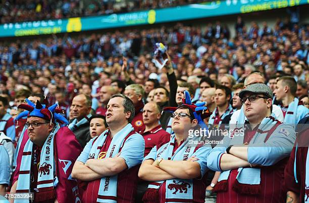 Aston Villa fans look dejected during the FA Cup Final between Aston Villa and Arsenal at Wembley Stadium on May 30 2015 in London England