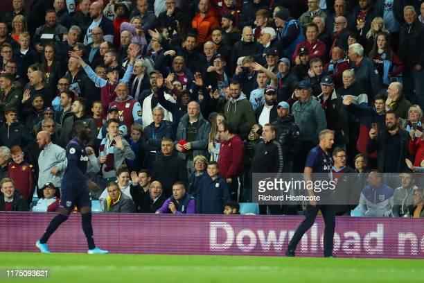 Aston Villa fans wave at Arthur Masuaku of West Ham United after he was sent off during the Premier League match between Aston Villa and West Ham...