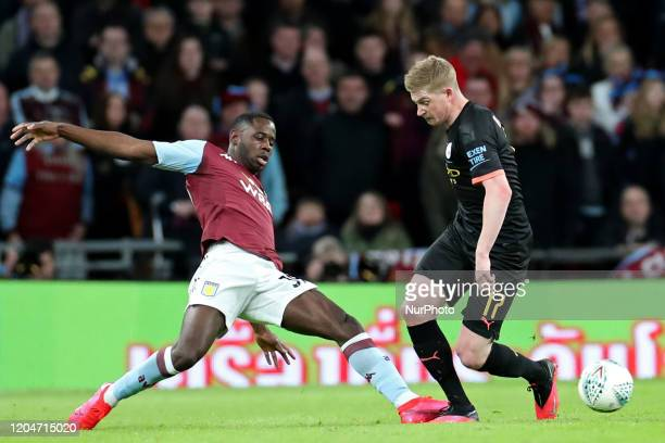Aston Villa forward Keinan Davis tackles Manchester City midfielder Kevin de Bruyne during the Carabao Cup Final between Aston Villa and Manchester...