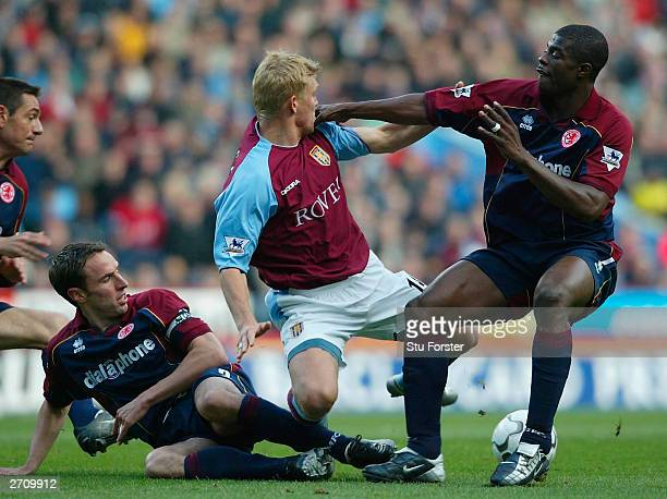 Aston Villa forward Marcus Allback is crowded out by Boro defenders Gareth Southgate and George Boateng during the Barclaycard Premiership match...
