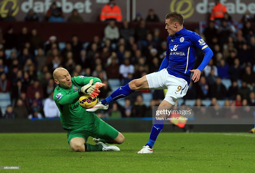 Aston Villa goalkeeper, Brad Guzan denies Jamie Vardy of Leicester City during the Barclays Premier League match between Aston Villa and Leicester City at Villa Park on December 7, 2014 in Birmingham, England.