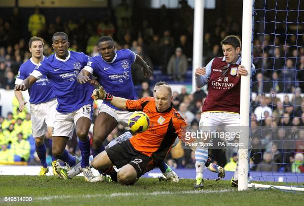 Aston Villa goalkeeper Bradley Guzan denies Everton's Victor Anichebe a chance on goal