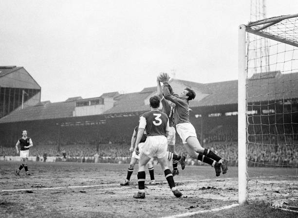 Aston Villa goalkeeper Nigel Sims catches the ball under pressure during the match between Chelsea and Aston Villa at Stamford Bridge in London, 30th...