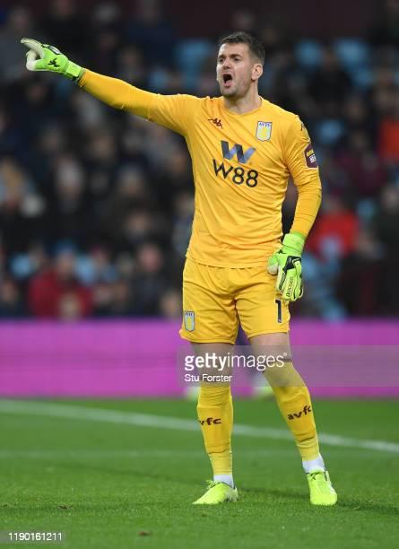 Aston Villa goalkeeper Tom Heaton reacts during the Premier League match between Aston Villa and Newcastle United at Villa Park on November 25 2019...