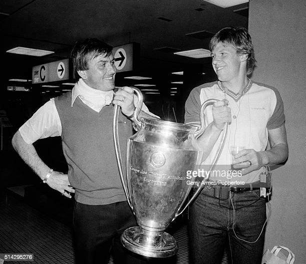 Aston Villa goalkeepers Jimmy Rimmer and Nigel Spink holding the European Cup at Rotterdam airport the morning after Villa's 10 victory over Bayern...