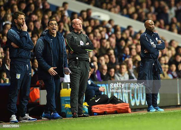 Aston Villa goalkeeping coach Tony Parks shouts as Tim Sherwood manager of Aston Villa and Chris Ramsey manager of QPR look on during the Barclays...