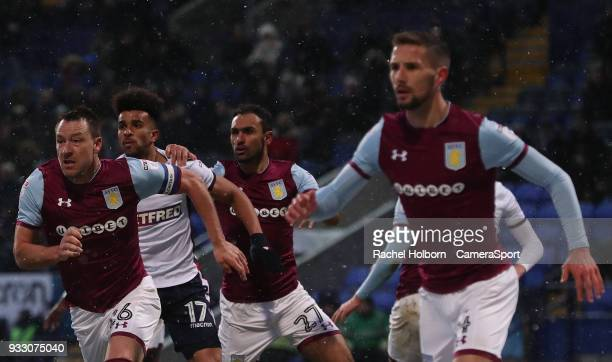 Aston Villa John Terry and Bolton Wanderers' Derik Osede during the Sky Bet Championship match between Bolton Wanderers and Aston Villa at Macron...