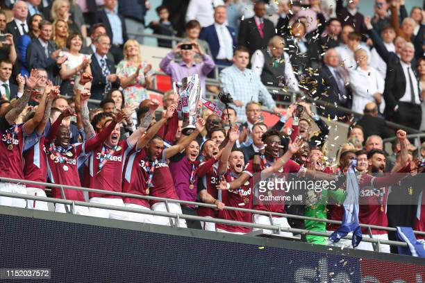 Aston Villa lift the trophy following victory in the Sky Bet Championship Playoff Final match between Aston Villa and Derby County at Wembley Stadium...