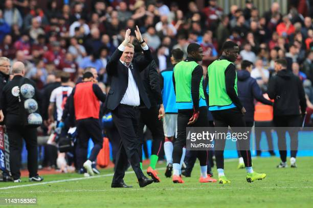 Aston Villa Manager Dean Smith applauds the fans after the Sky Bet Championship Play Off Semi Final first leg match between Aston Villa and West...