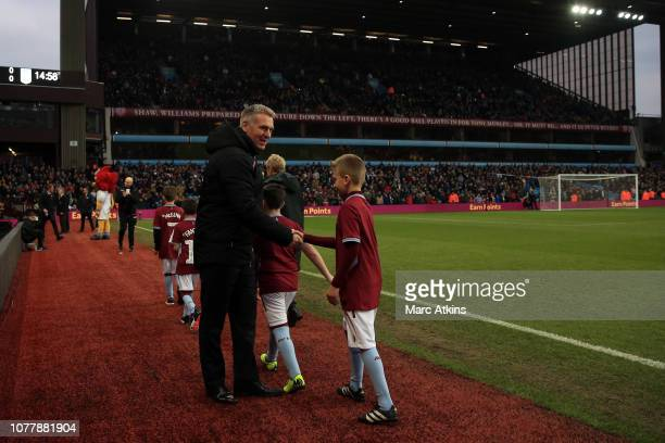 Aston Villa manager Dean Smith greets the mascots prior to the FA Cup Third Round match between Aston Villa and Swansea City at Villa Park on January...
