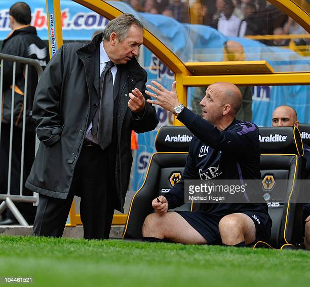 Aston Villa manager Gerard Houllier talks to his assistant Gary McAllister during the Barclays Premier League match between Wolverhampton Wanderers...