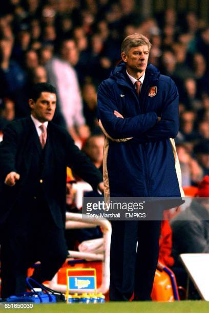Aston Villa manager John Gregory urges his team on during the game as Arsenal manager Arsene Wenger looks on