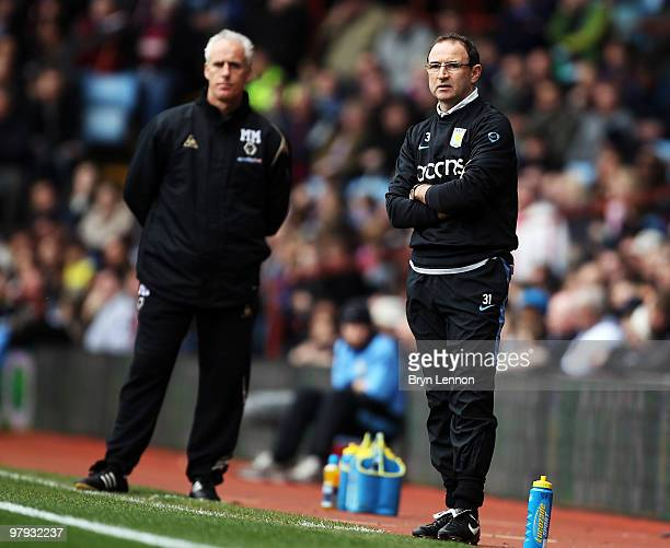 Aston Villa Manager Martin O'Neill and Wolves Manager Mick McCarthy watch the Barclays Premier League match between Aston Villa and Wolverhampton...
