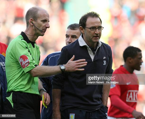 Aston Villa manager Martin O'Neill argues with referee Mike Riley as they leave the pitch after the final whistle