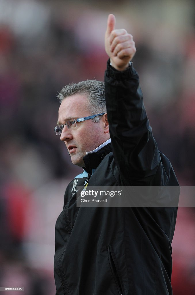 Aston Villa Manager Paul Lambert gives a thumbs up to the fans at the end of the Barclays Premier League match between Stoke City and Aston Villa at the Britannia Stadium on April 6, 2013 in Stoke on Trent, England.