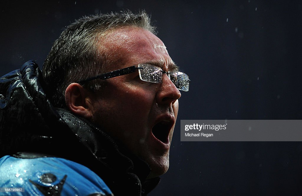 Aston Villa manager Paul Lambert shouts instructions in the rain during the Barclays Premier League match between Aston Villa and Wigan Athletic at Villa Park on December 29, 2012 in Birmingham, England.