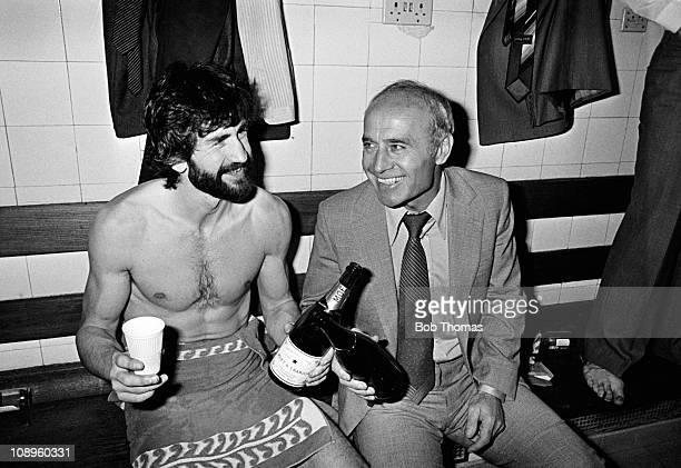 Aston Villa manager Ron Saunders and captain Dennis Mortimer celebrate in the dressingroom after winning the First Division League Championship in...