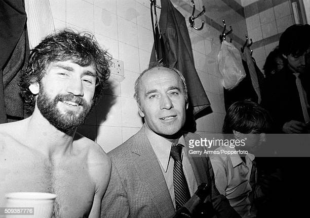 Aston Villa manager Ron Saunders and captain Dennis Mortimer celebrating in the dressingroom at Highbury after Aston Villa had been confirmed as the...