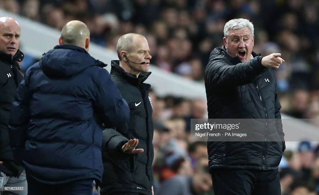 Aston Villa manager Steve Bruce (right) and Preston North End manager Alex Neil (second left) argue on the touchline during the Sky Bet Championship match at Villa Park, Birmingham.