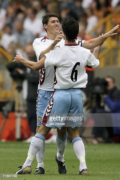 Aston Villa midfielder Gareth Barry celebrates with Liam Ridgwell after opening the scoring during the Preseason friendly match between Wolverhampton...