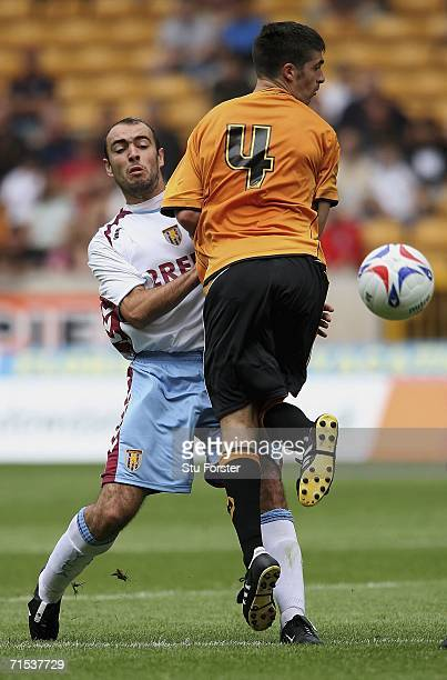 Aston Villa midfielder Gavin McCann tussles for the ball with Wolves player Kevin O'Connor during the Pre-season friendly match between Wolverhampton...