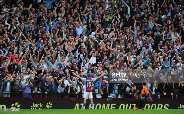 Aston Villa player Andreas Weimann takes the applause of the Holte end after scoring the third Villa goal during the Barclays Premier League match...