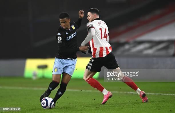 Aston Villa player Ezri Konsa beats Oliver Burke to the ball during the Premier League match between Sheffield United and Aston Villa at Bramall Lane...