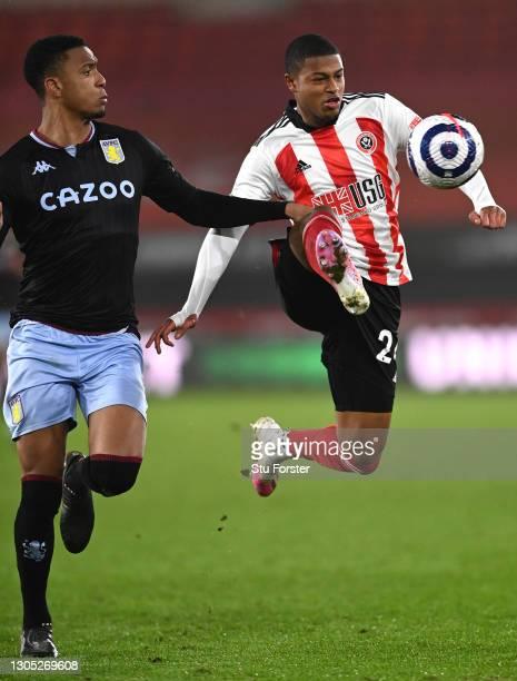Aston Villa player Ezri Konsa challenges Sheffield United striker Rhian Brewster during the Premier League match between Sheffield United and Aston...