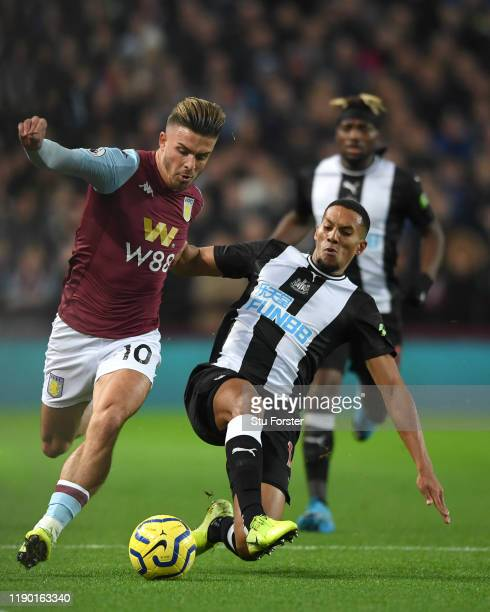 Aston Villa player Jack Grealish holds off the challenge of Isaac Hayden during the Premier League match between Aston Villa and Newcastle United at...