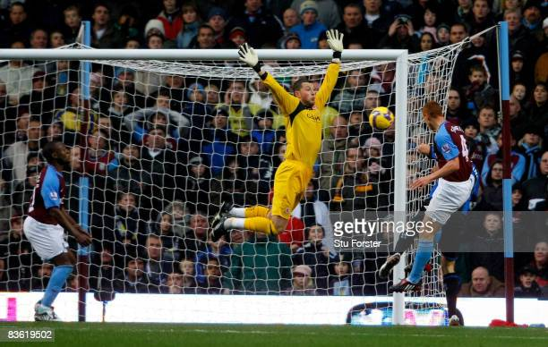 Aston Villa player Steve Sidwell heads past Middlesbrough goalkeeper Ross Turnbull to score the first Villa goal during the Barclays Premier League...
