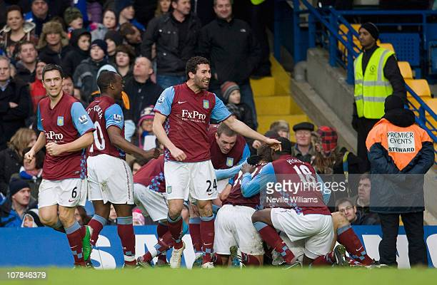 Aston Villa players celebrate after Ciaran Clark scored his team's third goal during the Barclays Premier League match between Chelsea and Aston...