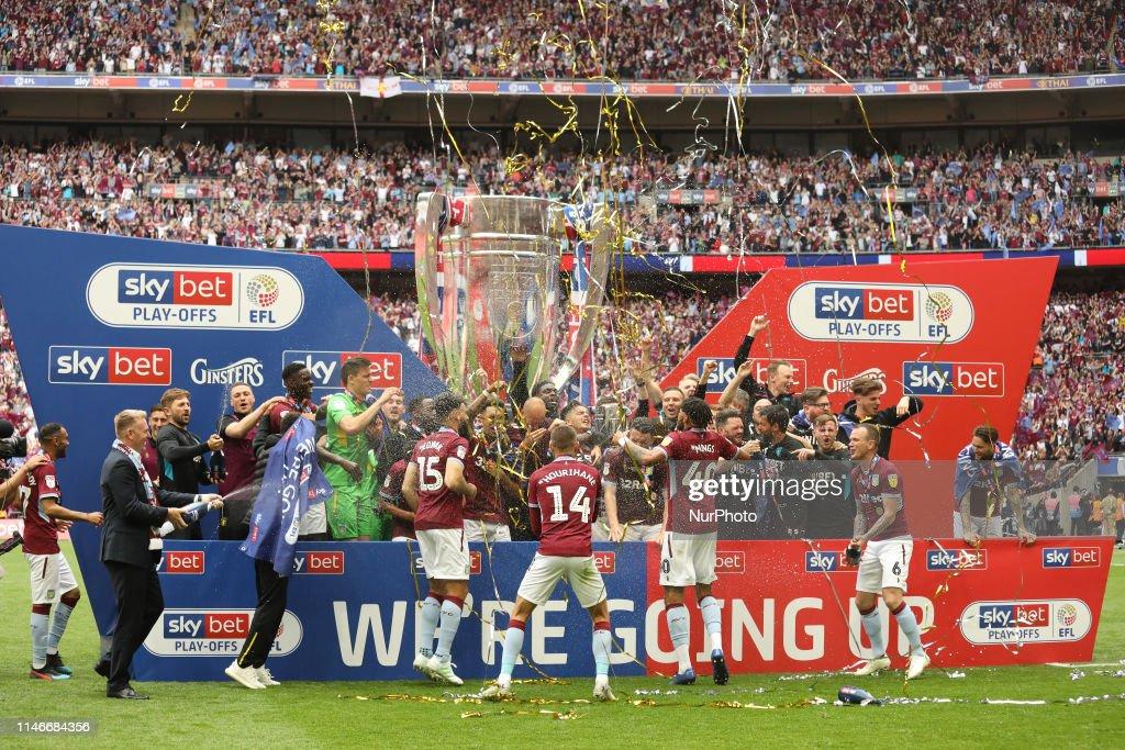 Aston Villa players celebrate after winning the EFL