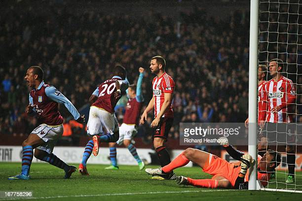 Aston Villa players celebrate as Christian Benteke of Aston Villa rises above the Sunderland defence to score his sides fourth goal during the...