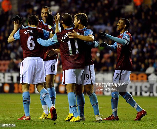 Aston Villa players celebrate the opening own goal scored by James McCarthy of Wigan during the Barclays Premier League match between Wigan Athletic...