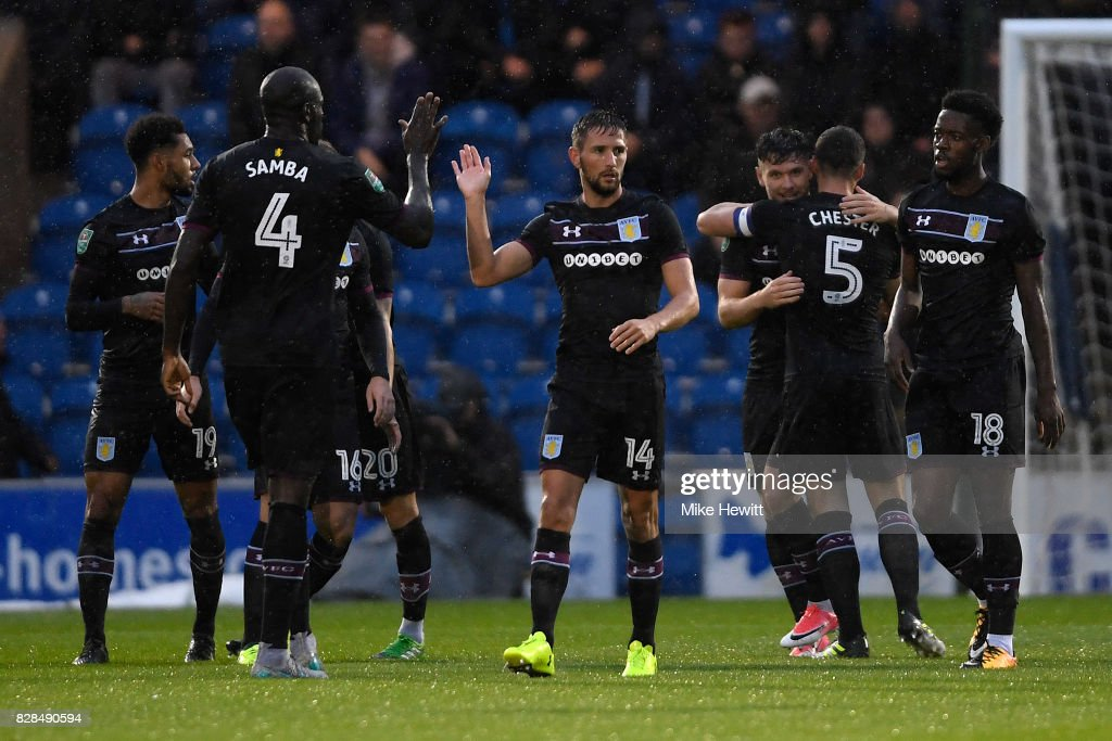 Aston Villa players celebrate their first goal, scored by Scott Hogan (3rd R), during the Carabao Cup First Round match between Colchester United and Aston Villa at Colchester Community Stadium on August 9, 2017 in Colchester, England.