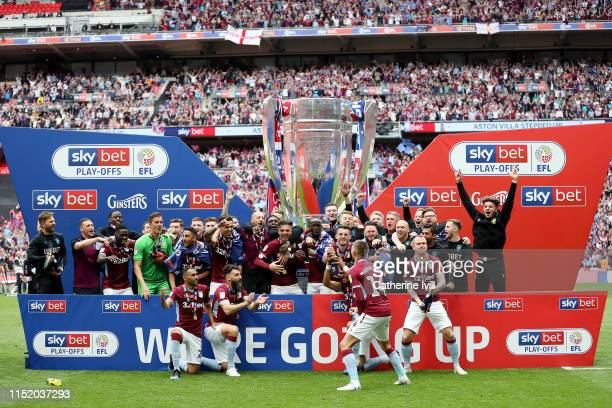 Aston Villa players celebrate victory following the Sky Bet Championship Playoff Final match between Aston Villa and Derby County at Wembley Stadium...