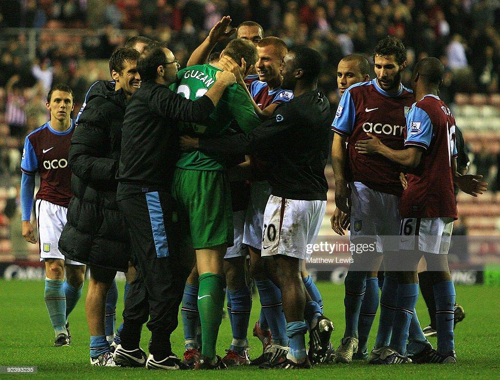 Aston Villa players congratulate Brad Guzan, after winning the Carling Cup 4th Round match between Sunderland and Aston Villa at the Stadium of Light on October 27, 2009 in Sunderland, England.